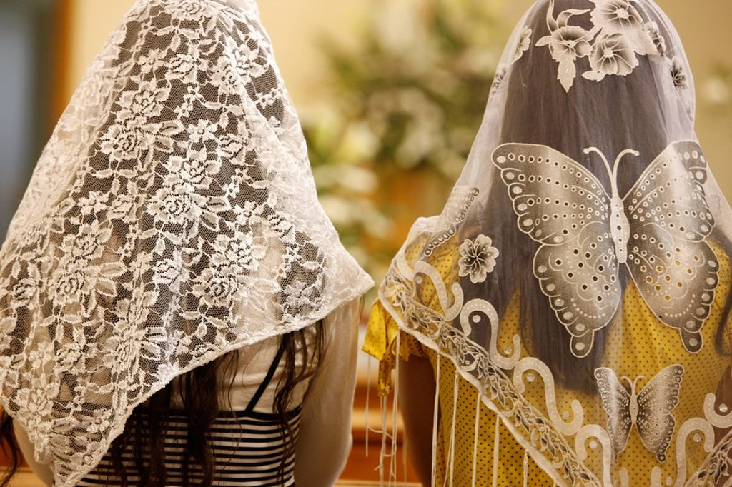 Women wearing embroidered veils at Holy Mass, Beit Jala, West Bank, Palestine National Authority, Middle East : Stock Photo