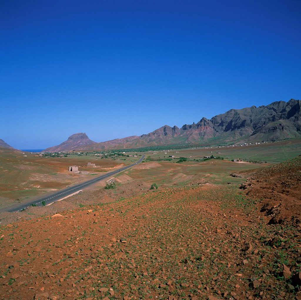 Stock Photo: 1890-11112 Road across a volcanic crater, with small buildings in the distance, inland on the island of Sao Vicente, Republic of Cape Verde Islands, Atlantic, Africa