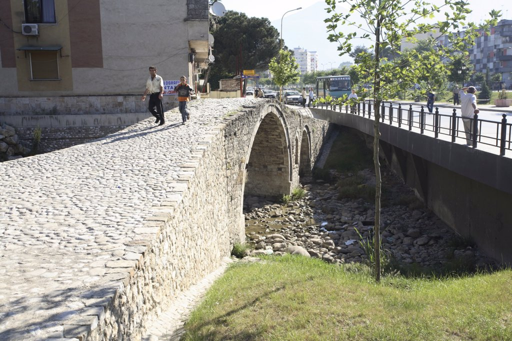 Stock Photo: 1890-111500 People walking over the Tanner´s bridge, an Ottoman stone footbridge in Tirana, Albania, Europe
