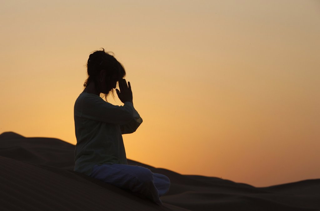 Stock Photo: 1890-111821 Sunset meditation in the desert, Abu Dhabi, United Arab Emirates, Middle East
