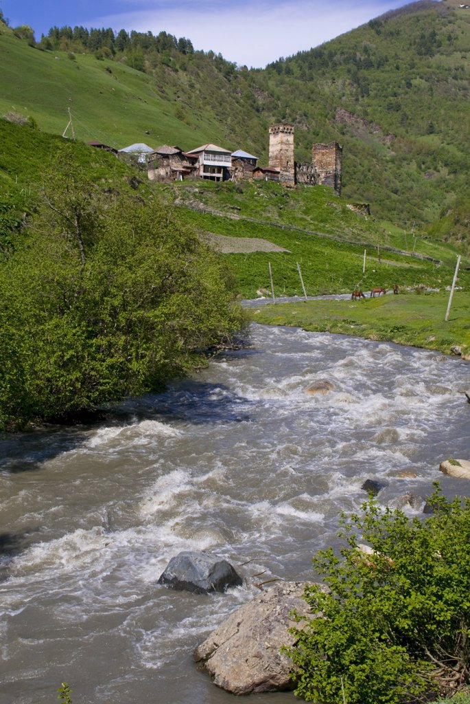 Little river running below a fortified mountain village, Svanetia, Georgia, Caucasus, Central Asia, Asia : Stock Photo