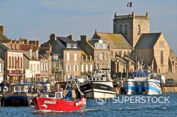Harbour and fishing boats with houses and church in the background, Barfleur, Manche, Normandy, France, Europe : Stock Photo