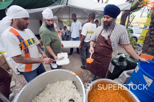 Preparing food for distribution with United Sikhs after the January 2010 earthquake, Port au Prince, Haiti, West Indies, Caribbean, Central America : Stock Photo