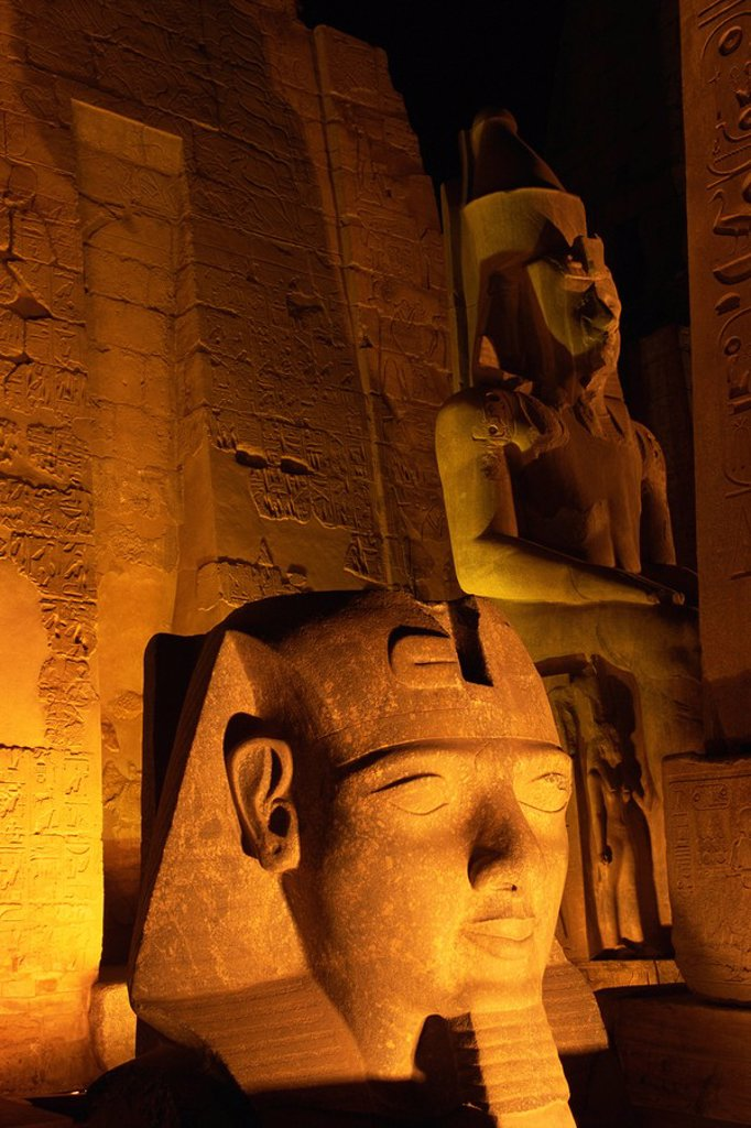 Stock Photo: 1890-116624 Floodlit statues of Ramses II, Temple of Luxor, UNESCO World Heritage Site, Luxor, Thebes, Egypt, North Africa, Africa