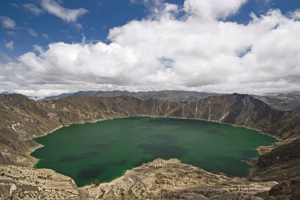 Laguna Quilatoa, famous volcanic crater with 250m deep green lake of alkaline water, west of Latacunga, Cotopaxi Province, Central Highlands, Ecuador, South America : Stock Photo