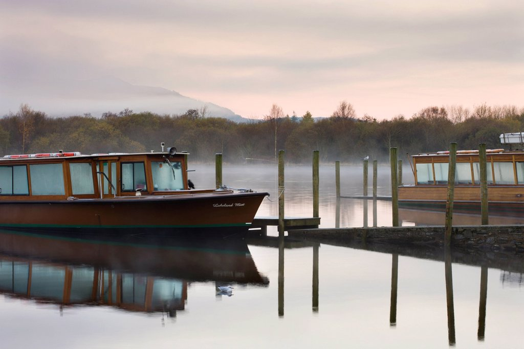 Lakeland Mist boat moored on Derwent Water on a misty autumn morning, Keswick, Lake District National Park, Cumbria, England, United Kingdom, Europe : Stock Photo