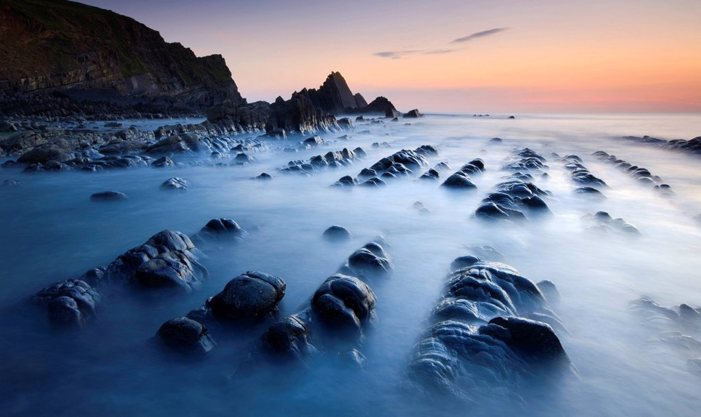 Stock Photo: 1890-120432 High tide gradually submerges the rocky shores of Blegberry Bay at sunset, Hartland, Devon, England, United Kingdom, Europe