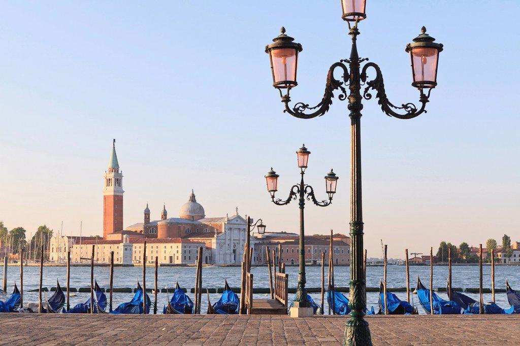 Gondolas moored on the Lagoon, San Giorgio Maggiore beyond, Riva degli Schiavoni, Venice, UNESCO World Heritage Site, Veneto, Italy, Europe : Stock Photo