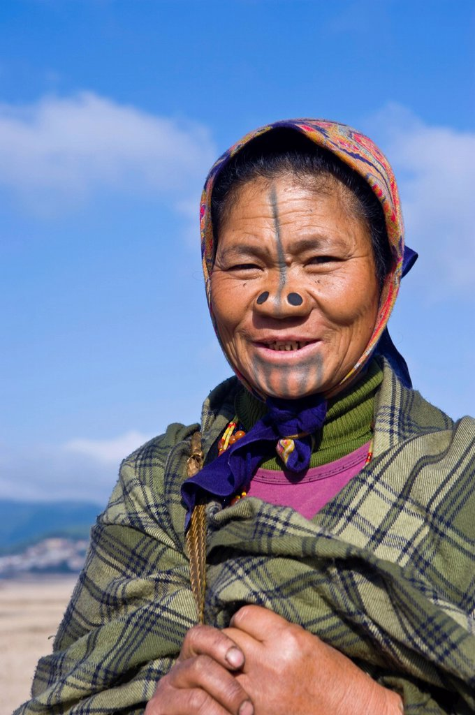 Stock Photo: 1890-123953 Old woman of the Apatani tribe famous for the wooden pieces in their nose to make them ugly, Ziro, Arunachal Pradesh, Northeast India, India, Asia