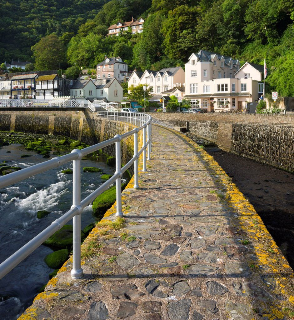 Stock Photo: 1890-126289 Stone harbour wall and village of Lynmouth on a summer morning, Exmoor National Park, Devon, England, United Kingdom, Europe
