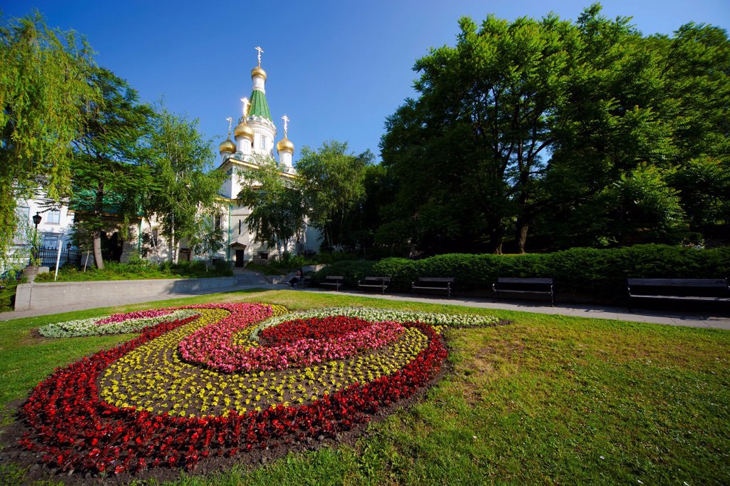 Stock Photo: 1890-128022 Flower bed in gardens with Church of St. Nicholas the Miracle Maker The Russian Church, behind, Boulevard Tsar Osvoboditel, Sofia, Bulgaria, Europe