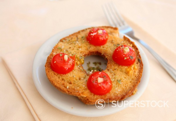 Stock Photo: 1890-129845 Italian food of friselle with tomato, cheese, olive oil , salt and oregano, Italy, Europe