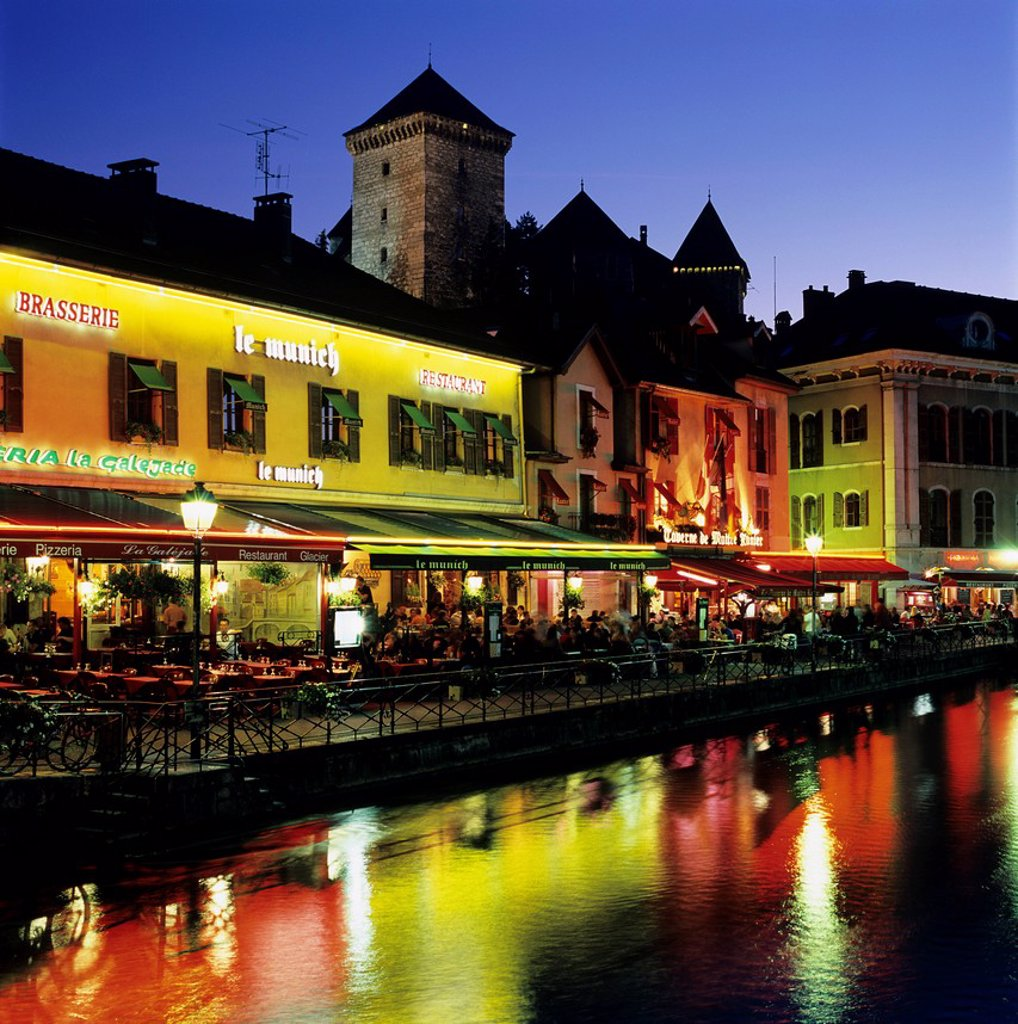 Stock Photo: 1890-130569 Canal side restaurants below the Chateau at dusk, Annecy, Lake Annecy, Rhone Alpes, France, Europe