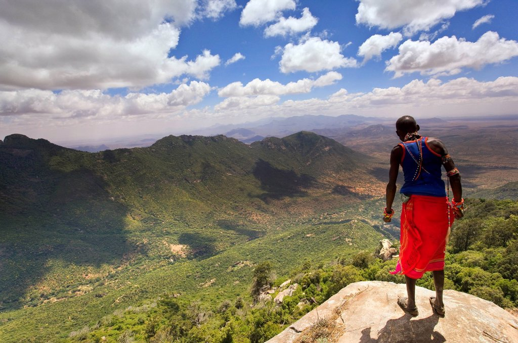 Samburu man looks down over the Ewaso Rongai Valley from Mount Nyiru, Northern Frontier, Kenya, East Africa, Africa : Stock Photo