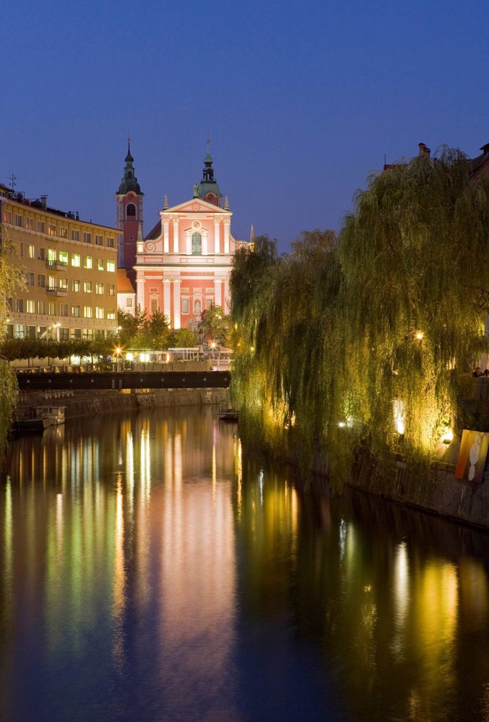 The Church of the Annunciation on the Ljubljanica River at dusk, Ljubljana, Slovenia, Europe : Stock Photo