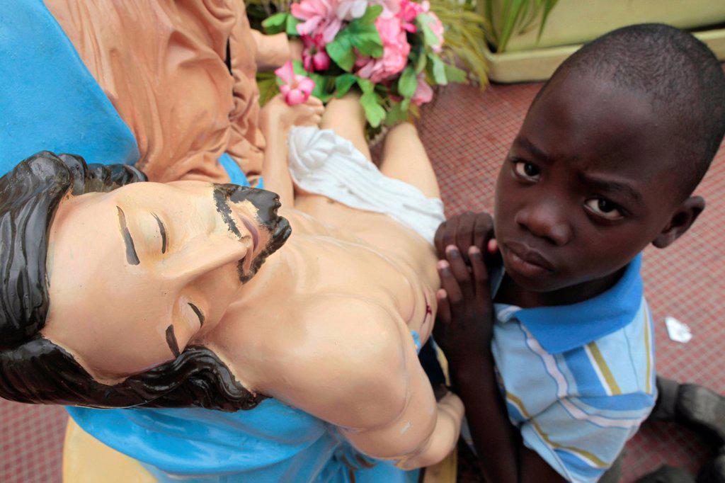 Stock Photo: 1890-132126 African boy praying, Cotonou, Benin, West Africa, Africa