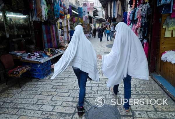 Stock Photo: 1890-132319 Two Palestinian female youngsters wearing a hijab on their way to pray, Old City, Jerusalem, Israel, Middle East