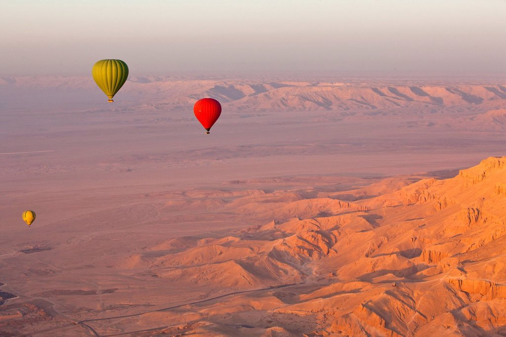 Stock Photo: 1890-132474 Hot air balloons suspended over the Theban hills of Luxor and the Valley of the Queens at sunrise, Thebes, UNESCO World Heritage Site, Egypt, North Africa, Africa