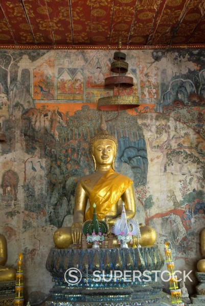 Stock Photo: 1890-132557 Seated Buddha statue with murals in the background, Wat Pak Huak, Luang Prabang, Laos, Indochina, Southeast Asia, Asia