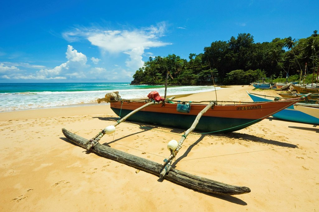 Stock Photo: 1890-132983 Outrigger fishing boat at this quiet south coast retreat beach, Talalla, near Matara, Southern Province, Sri Lanka, Asia