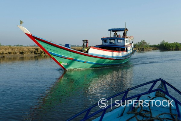 Boat on waterway in the Irrawaddy delta, Myanmar Burma, Asia : Stock Photo