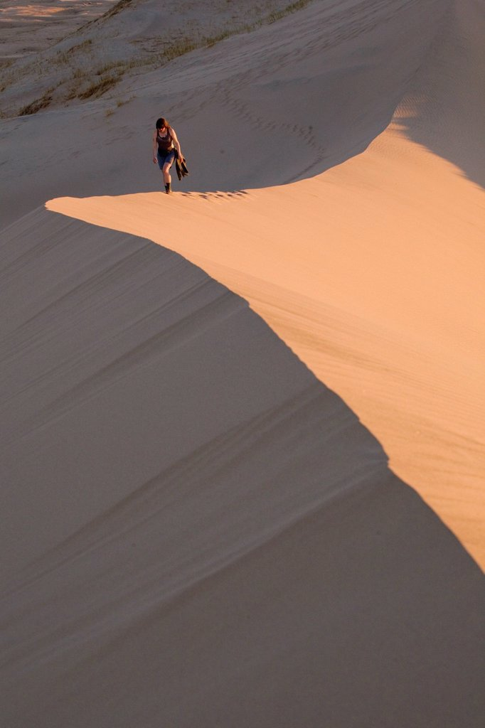 Stock Photo: 1890-134858 Woman walking through Kelso Dunes, Mojave Desert National Reserve, California, United States of America, North America