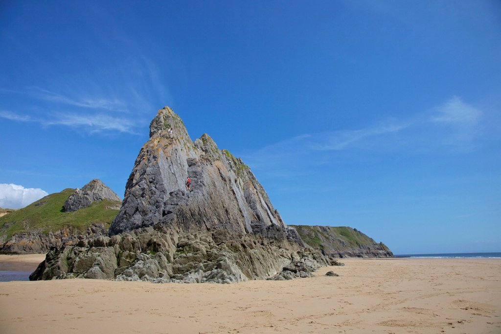 Two rock climbers on the Three Cliffs beach in spring morning sunshine, Gower Peninsula, County of Swansea, Wales, United Kingdom, Europe : Stock Photo