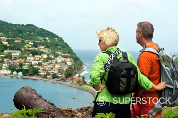 Couple at the remains of Scotts Fort atop Cachacrou headland overlooking Scotts Head, Dominica, Windward Islands, West Indies, Caribbean, Central America : Stock Photo