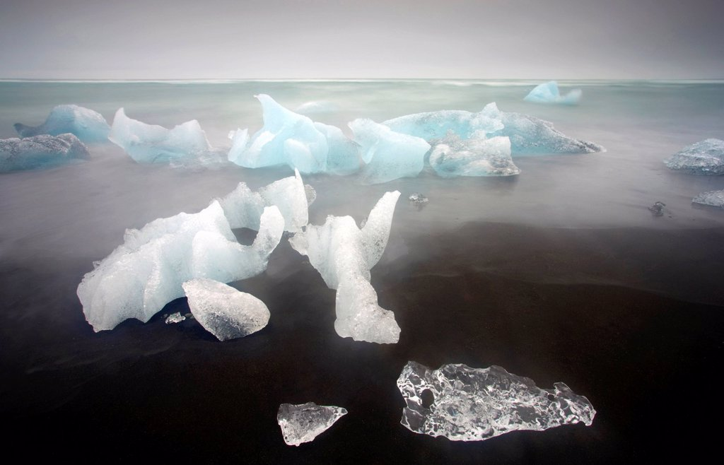 Stock Photo: 1890-136986 Icebergs from the Jokulsarlon glacial lagoon washed up on a nearby black volcanic sand beach from the North Atlantic Ocean, Iceland, Polar Regions