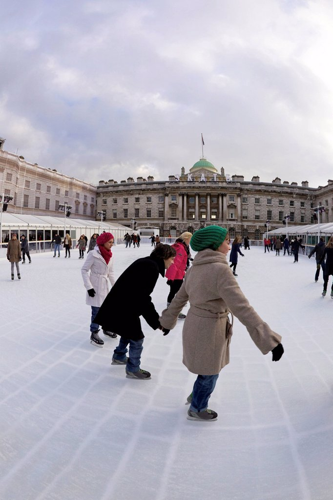Stock Photo: 1890-137593 Skaters skating on outside ice rink, Somerset House, London, England, United Kingdom, Europe
