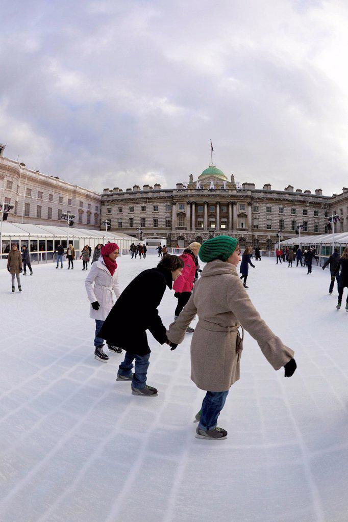 Skaters skating on outside ice rink, Somerset House, London, England, United Kingdom, Europe : Stock Photo