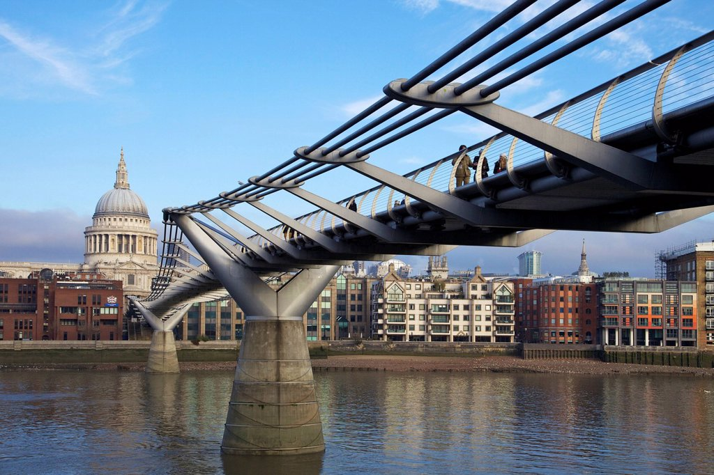 Pedestrians on Millennium Bridge, crossing the River Thames, taken from Bankside looking to St. Pauls Cathedral, London, England, United Kingdom, Europe : Stock Photo