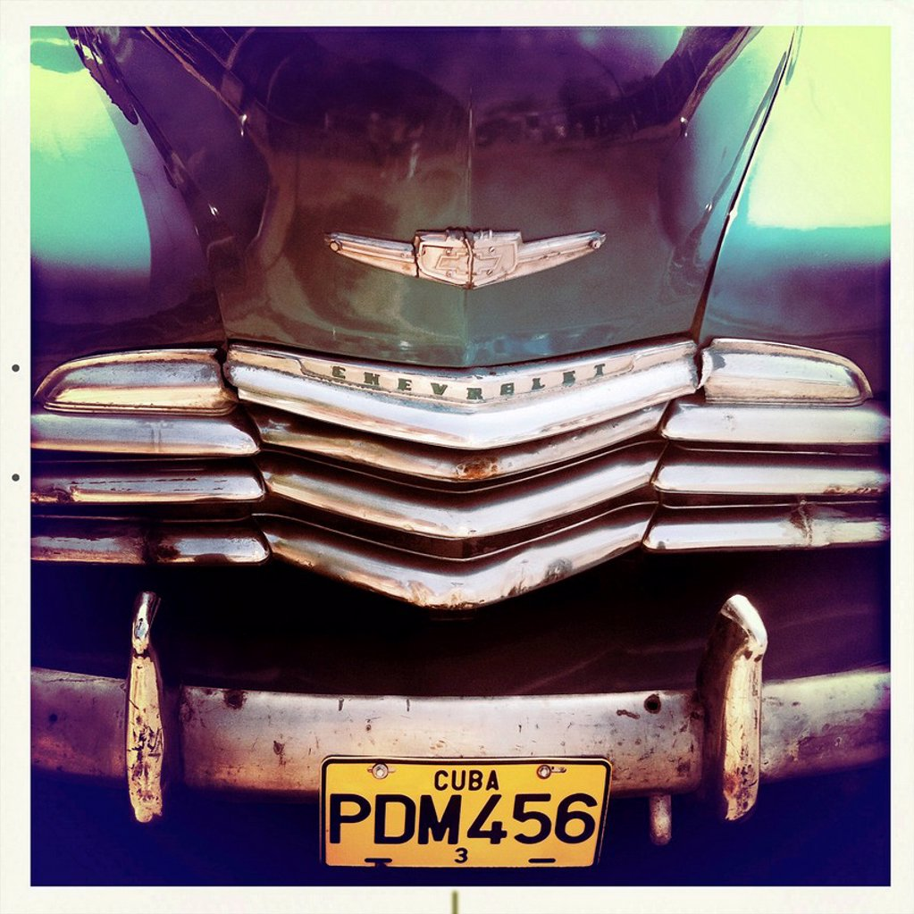 Stock Photo: 1890-138624 Detail of the front of an old green Chevrelet showing the chrome grill and numberplate, Vinales, Cuba, West Indies, Central America