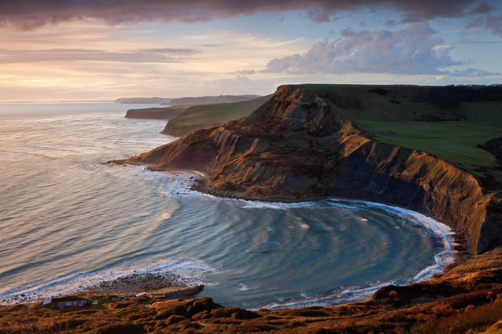 Stock Photo: 1890-138741 Storm light illuminates Chapmans Pool and Houns Tout cliff, viewed from St. Aldhelm´s Head, Jurassic Coast, UNESCO World Heritage Site, Dorset, England, United Kingdom, Europe