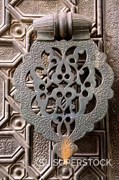 Bronze knocker on wooden engraved doors, Reales Alcazares, Seville, Andalucia, Spain, Europe : Stock Photo