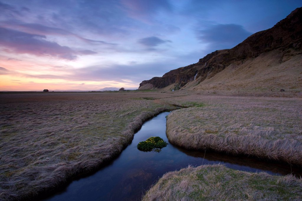 Stream meandering into the distance and reflecting colours in the twilight sky, near Hella, South Iceland, Iceland, Polar Regions : Stock Photo