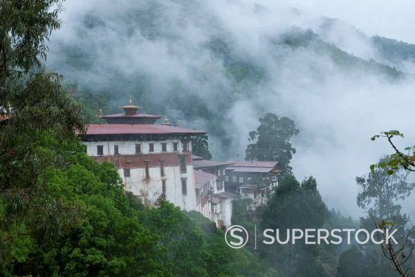 Stock Photo: 1890-141280 View of the Dzong with hills and fog, Trongsa, Bhutan, Asia