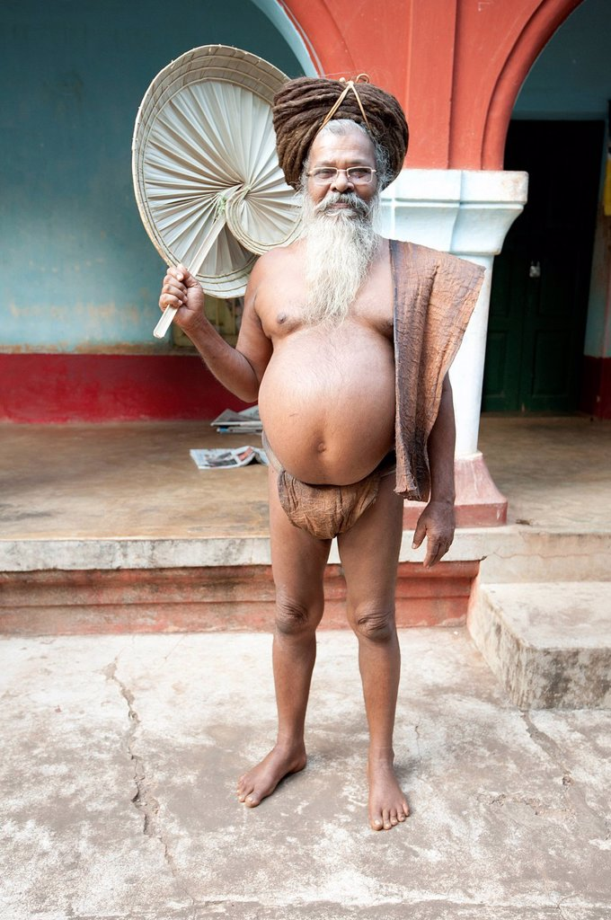 Stock Photo: 1890-141706 Joranda monk wearing tree bark loincloth, holding palm leaf fan, with uncut hair piled up on top of his head, Joranda, Orissa, India, Asia