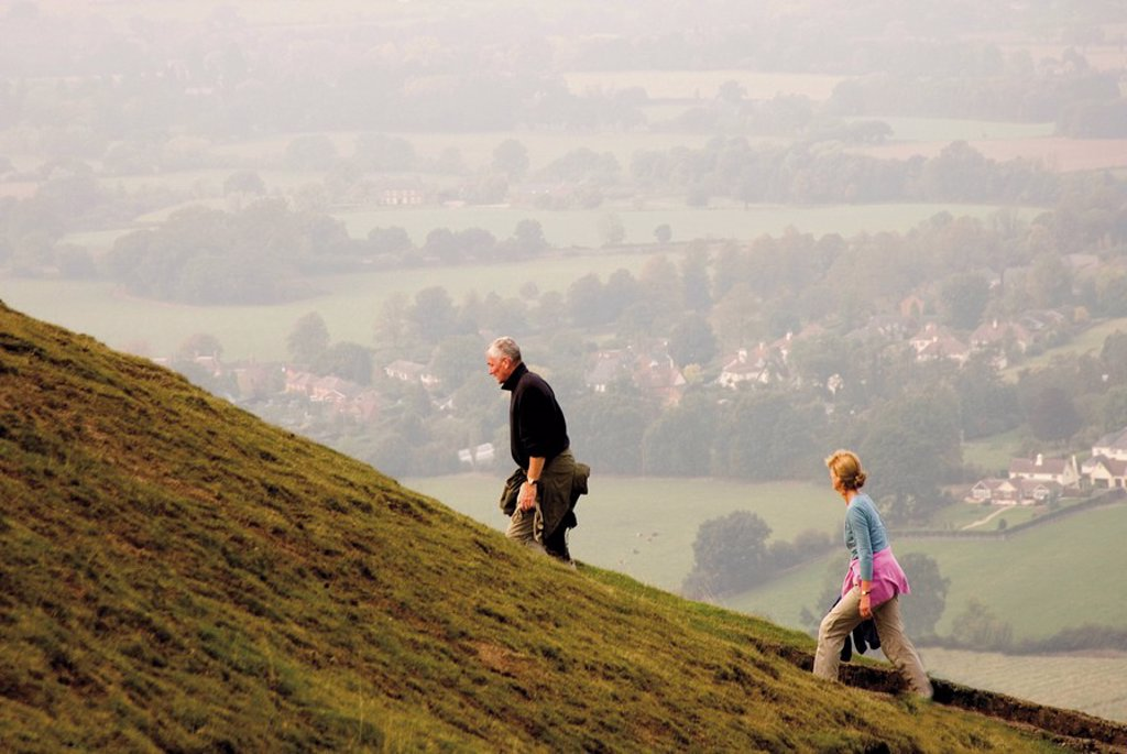 Stock Photo: 1890-14227 Couple walking, British Camp, Hereford Beacon, Malvern Hills, Herefordshire, Midlands, England, United Kingdom, Europe