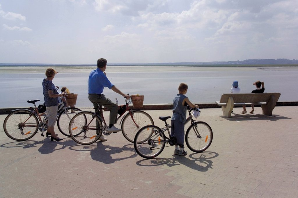Family on bicycles, Le Crotoy, Somme Estuary, Picardy, France, Europe : Stock Photo