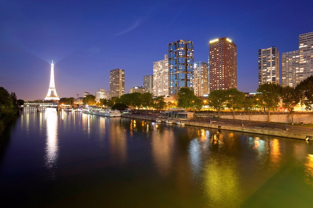 Stock Photo: 1890-142531 Night view of River Seine with high_rise buildings on the Left Bank, and Eiffel Tower, Paris, France, Europe