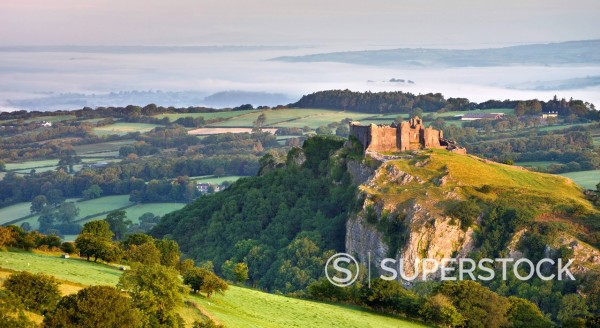 Carreg Cennen Castle at dawn on a misty summer morning, Brecon Beacons National Park, Carmarthenshire, Wales, United Kingdom, Europe : Stock Photo