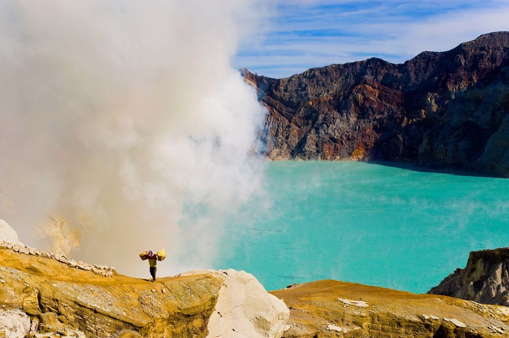 Stock Photo: 1890-144183 Sulphur worker appearing out of toxic fumes at Kawah Ijen, East Java, Indonesia, Southeast Asia, Asia