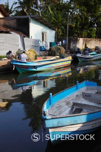 Fishermen fixing nets along Hamilton Canal, an old Dutch canal, Negombo, Western Province, Sri Lanka, Asia : Stock Photo