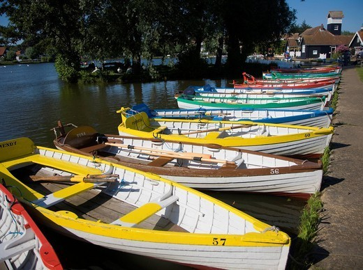 Rowing boats lined up on the Meare boating lake, Thorpeness, Suffolk, England, United Kingdom, Europe : Stock Photo