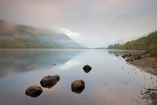 Stock Photo: 1890-146951 Loch Voil shrouded in mist at dawn in autumn, Balquhidder, Loch Lomond and The Trossachs National Park, Stirling, Scotland, United Kingdom, Europe