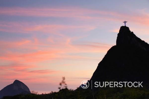 Christ the Redeemer statue Cristo Redentor at sunset, Corvocado, Rio de Janeiro, Brazil, South America : Stock Photo