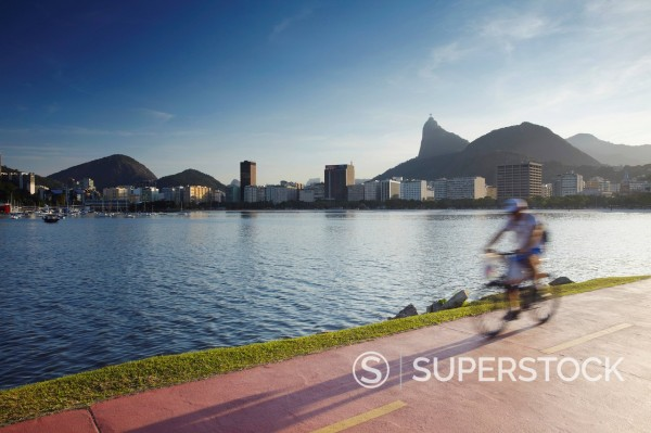 Stock Photo: 1890-153599 Cyclist on pathway around Botafogo Bay with Christ the Redeemer statue Cristo Redentor in the background, Rio de Janeiro, Brazil, South America