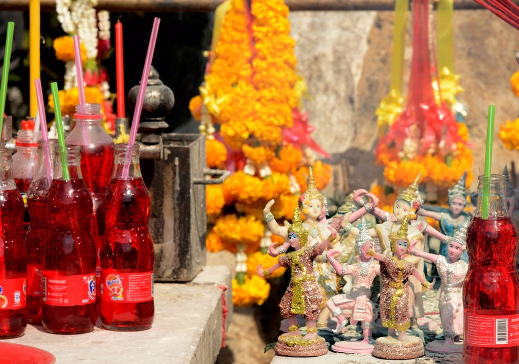 Stock Photo: 1890-160223 Red drinks offered to a Pig shrine, the Pig is the astrological symbol of the year a past queen was born, Bangkok, Thailand. Southeast Asia, Asia
