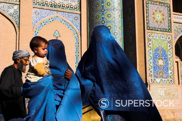 Stock Photo: 1890-16548 Ladies wearing blue burqas outside the Friday Mosque Masjet_e Jam, Herat, Afghanistan, Asia